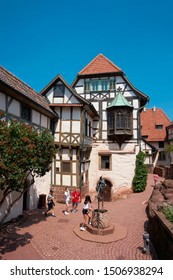 EISENACH, GERMANY – JUNE 04, 2019: Children of a travel group in the historic courtyard of the Wartburg Castle near Eisenach in Thuringia