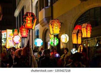 Eisengasse, Basel, Switzerland - March 11th, 2019. Close-up of a carnival group carrying illuminated stick lanterns