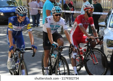Ejea de los Caballeros, Spain - September 13, 2018: Enric Mas Nicolau, Jonathan Castroviejo, Loic Chetout approaching to the start of Vuelta de Espana, stage 18