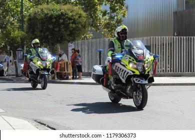 Ejea de los Caballeros, Spain - September 13, 2018: A Spanish policeman riding a motorcycle at the Vuelta de Espana start, stage 18