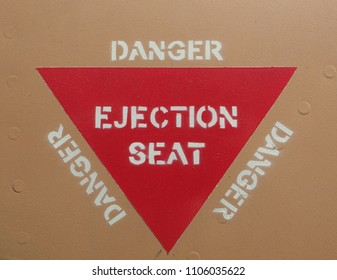 Ejection seat warning sign on fuselage background