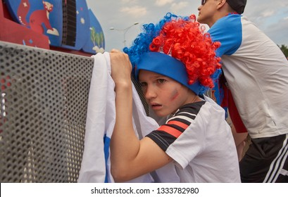 Ekaterinburg, Russia. 06/25/2018  The boy, disappointed with the game of the national football team, does not look towards the screen. FIFA World Cup 2018. Ekaterinburg. Fanzone.