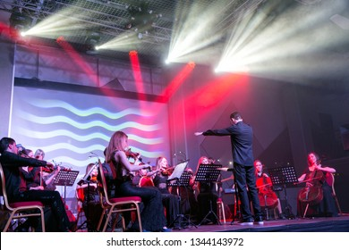 Ekaterinburg, Russia - February 16, 2018: Performance of the orchestra in the rays of the spotlights