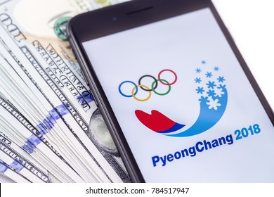 Ekaterinburg, Russia - January 1, 2018: Brand black Apple iPhone 8+ and Official logo of the 2018 Winter Olympic Games in PyeongChang, Republic of Korea, from February 9 to February 25, 2018