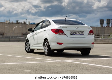 Ekaterinburg, Russia, July 03, 2017 - Hyundai Solaris car (Accent) in a shopping center parking on a cloudy day