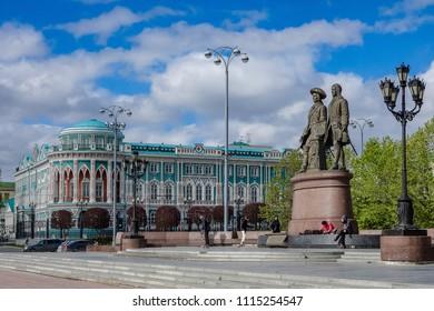 Ekaterinburg Russia - June 2018 Monument to Tatishchev and De Genninou and Dom Sevast'yanova in Ekaterinburg 2018