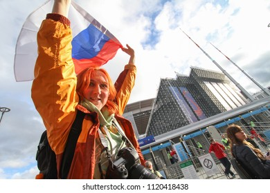 Ekaterinburg, RUSSIA - June 21, 2018: Girl fan with russia flag. Fifa World Cup 2018  soccer football fans walking in Ekaterinburg