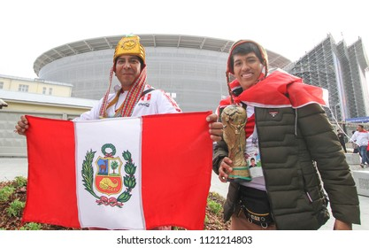 Ekaterinburg, RUSSIA - June 21, 2018: Peruvian fans with flag. Fifa World Cup 2018 soccer football fans walking in Ekaterinburg and takes pictures with people