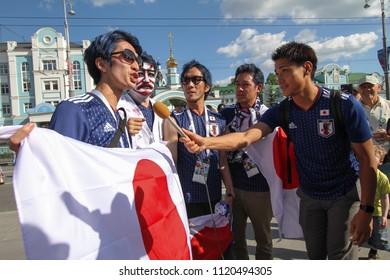 EKATERINBURG, RUSSIA - June 24, 2018: Fans football answer interview for tv. Fifa 2018 in Ekaterinburg. World cup 2018 Senegal vs Japan.