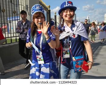 EKATERINBURG, RUSSIA - June 24, 2018: Two girls japan's - fans football fifa 2018 take the pictures on a fan festival in Ekaterinburg. World cup 2018 Senegal vs Japan.