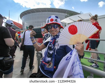 EKATERINBURG, RUSSIA - June 24, 2018: Japan man - fan football fifa 2018 with the simbols of Japan on a fan festival in Ekaterinburg. World cup 2018 Senegal vs Japan.