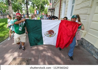 Ekaterinburg, RUSSIA - June 27, 2018: Group of fans mexican with flage on the street. Mexico v Sweden FIFA 2018 World Cup Russia Round of 16