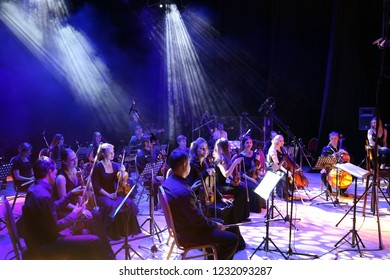 "Ekaterinburg, Russia - November 03, 2018: Orchestra Concert ""Other Band"". Concert of the symphony orchestra under bright scenic spotlights"