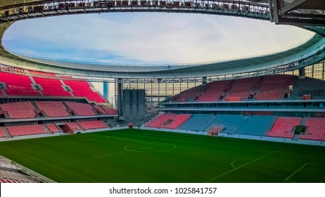 EKATERINBURG, RUSSIA -OCTOBER 07, 2017: The construction of a new stadium for the 2018 world Cup football . inside view on green grass field, dome, canopy and tribune seats.