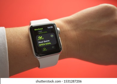 Ekaterinburg, Russia - October 2019. Apple Watch Series 3 on red background. New smartwatch from APPLE company close up isolated on white background. smart watch on your wrist