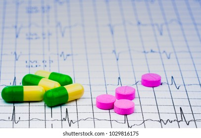 EKG or ECG (Electrocardiogram) graph report paper. EST ( Exercise Stress Test ) result and pills. Package promotion for heart check up in senior or elderly people concept. Warfarin and tramadol pill.