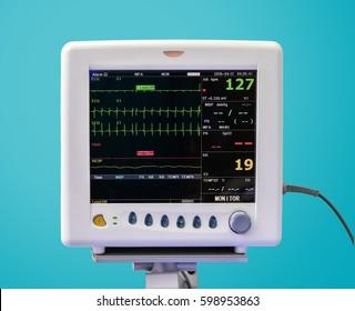 EKG Monitor in ICU Unit on Blue Background