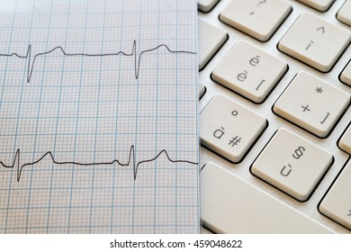 ekg paper and personal computer keyboard
