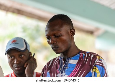 EKPA, BENIN - JAN 12, 2017: Unidentified Benin man works in a school of predictions in Ekpa village, one of the local touristic attractions
