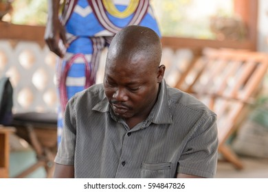 EKPA, BENIN - JAN 12, 2017: Unidentified Benin man works as a headmaster of the school of predictions in Ekpa village, one of the local touristic attractions
