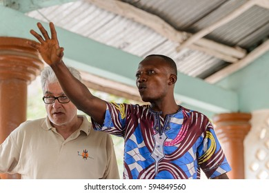 EKPA, BENIN - JAN 12, 2017: Unidentified Benin man explains  in a school of predictions in Ekpa village, one of the local touristic attractions