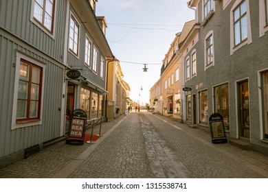 Eksjo, smaland, Sweden-January 18, 2019: Eksjo is a town in the south of Sweden with some old houses in red colors it was declared a city by  Eric of Pomerania in 1403, five people in the street