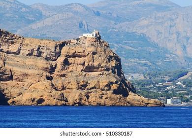 El Albir cape lighthouse over the cliffs of Altea village in Spain.