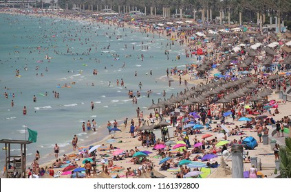 El Arenal, Mallorca / Spain - August    , 2018: General view over the crowded touristic beach of El Arenal in the Spanish island of Mallorca.