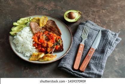 El Bistec a la Criolla  -  colombian dish traditional - beef steak with tomatoes sauce, rice, avocado, bananas fries