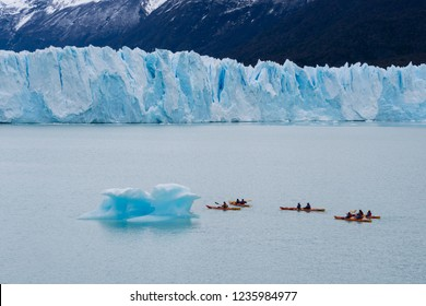El Calafate, Argentina - Sep 29, 2018: Tourists kayaking near the Perito Moreno Glacier in the Los Glaciares National Park in Argentina