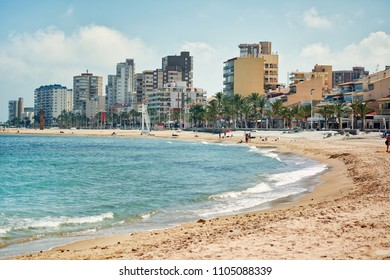 El Campello, Spain - May 22, 2018: Sandy beach and cityscape El Campello. El Campello is a coastal resort town on the Costa Blanca. Alicante, Spain