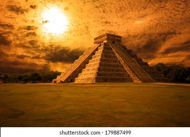 El Castillo (The Kukulkan Temple) of Chichen Itza complex at sunset, mayan pyramid in Yucatan, Mexico