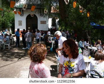 El Chorro, Spain - June 9, 2018: People enjoying themselves at local fiesta in Andalusian countryside