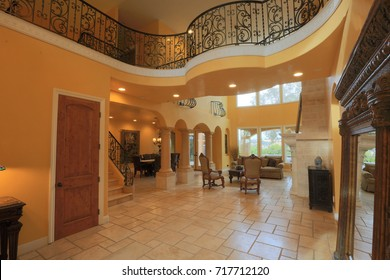 EL DORADO HILLS, CA, USA - SEP 18, 2017: Interior or luxurious custom meridian home in the most affluent neighborhood of Sacramento area. Entrance hall, fire place, formal living room.