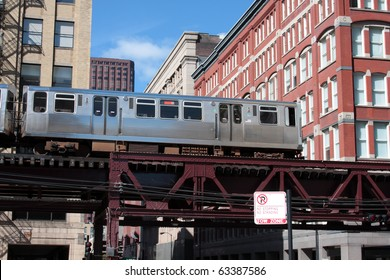 El. elevated, overhead commuter train in Chicago moving through the city.