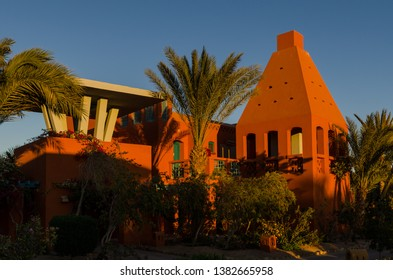 El Gouna, Egypt - January 7, 2012: Sunset time Bungalows and hotel buildings at Red Sea holiday resort