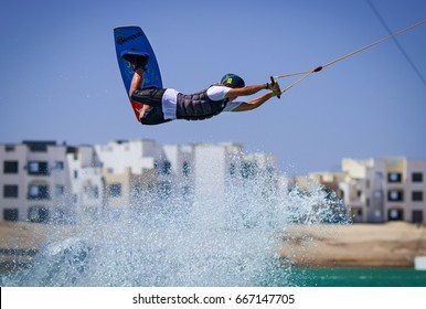 EL GOUNA, EGYPT - JUNE 27th 2017: Wakeboarding open men, juniors and women seasonal competition held on 27th of June 2017 at SLIDERS wake cable park, El Gouna, Egypt.