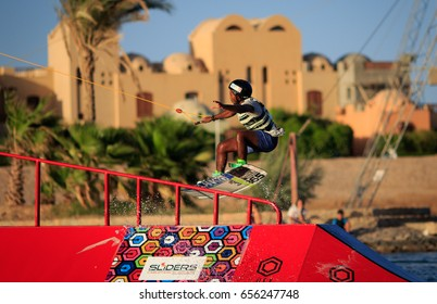 EL GOUNA, EGYPT - JUNE 8th 2017: Wakeboarding water sports - setting up and testing new wake cable park obstacles on 8th of June 2017 at SLIDERS wake cable park, El Gouna, Egypt.