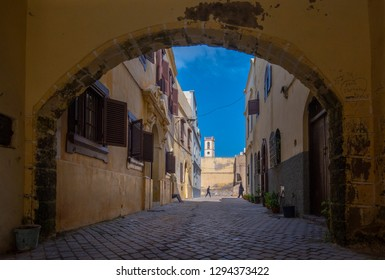 El Jadida, Morocco - 19 January, 2019: Street view of arch and houses in Mazagan. The City Wall around  it. It is a Portuguese Fortified Port City registered as a UNESCO World Heritage Site. Panorama