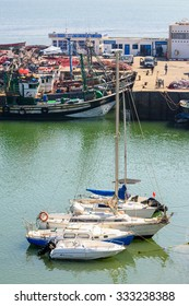EL JADIDA, MOROCCO - SEP 1, 2015: Boats on the coast near the Portuguese Fortified City of Mazagan, UNESCO World Heritage Site, El Jadida, Morocco
