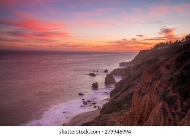 El Matador State beach as the setting sun casts a soft pink glow