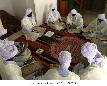 El Mechouar Palace, Tlemcen, Algeria - March 31, 2017: A scene of pilgrims whilde they are practising The Holy Quran.