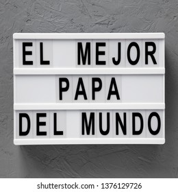 'El Mejor Papa Del Mundo' words on modern board over concrete background, top view. Overhead, from above, flat lay. Father's day.