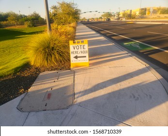 El Mirage, Arizona / USA - November 06, 2018: General Election Day directional sign saying Vote Here, also translated to Spanish