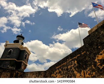 El Moro - Lighthouse and flags. Old San Juan, Puerto Rico