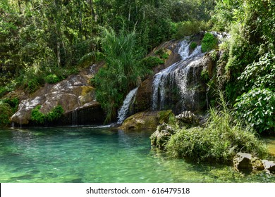 El Nicho Waterfalls in Cuba. El Nicho is located inside the Gran Parque Natural Topes de Collantes, a forested park that extends across the Sierra Escambray mountain range in central Cuba.