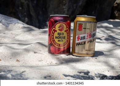 El Nido, Palawan - 25FEB2019 - Red Horse and San Miguel beer in sand.