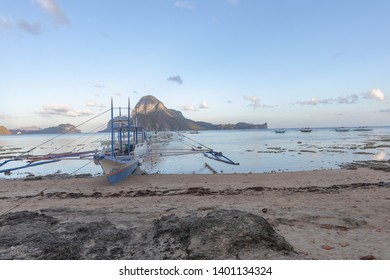El Nido, Palawan - 26FEB2019 - Boat on beach with mountain in background.