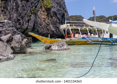 El Nido, Palawan - 26FEB2019 - Island hopping boats in El Nido, Palawan moored at a beach.