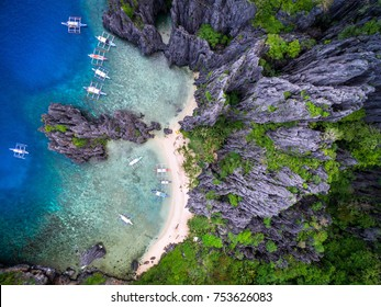 El Nido, Palawan, Philippines, aerial view of boats and limestone cliffs at Secret Lagoon beach.